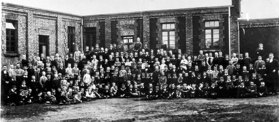 1890s-pupils-building-original-block,-dirt-quad