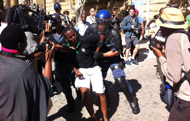 Police arrest a student identified as the son of the Rev Frank Chikane during the protests in the parliamentary precinct. Image by: JAMES-BRENT STYAN